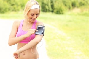Happy jogger using a smartphone